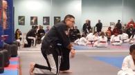 Mr. Kim watches belt test.