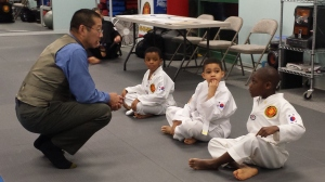 Mr. Lew talking to White Belts during belt testing.