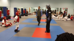 Blue belt sparring a black belt during IMA belt test.