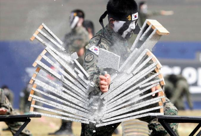 Members of the Special Warfare Command give a demonstration of their skills in the traditional Korean martial art of taekwondo during a photo opportunity ahead of a celebration to mark the 69th anniversary of Korea Armed Forces Day, in Pyeongtaek
